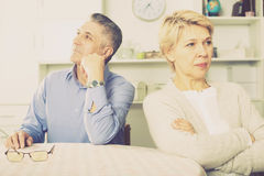 Mature couple quarrels. Senior couple quarrels with each other at clarification of the family relation in home stock photos