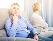 Mature couple quarrels. Senior husband and wife quarrels with each other at clarification of the family relation stock photography