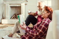 Mature couple reading book Stock Photography