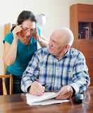 Mature couple reading financial documents Royalty Free Stock Photography