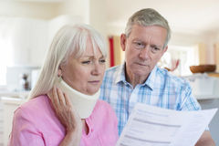 Mature Couple Reading Letter About Wife`s Injury. Mature Couple Read Letter About Wife`s Injury royalty free stock images