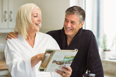 Mature couple reading magazine together in morning Stock Image