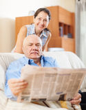 Mature couple reading newspaper  together Stock Images
