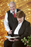 Mature Couple Reading Scripture at Christmastime Royalty Free Stock Images