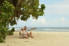 Mature couple relaxing on beach Stock Photography