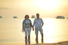 Mature couple relaxing on beach Royalty Free Stock Photos