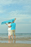 Mature couple relaxing on beach Stock Images
