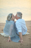 Mature couple relaxing on beach Royalty Free Stock Image