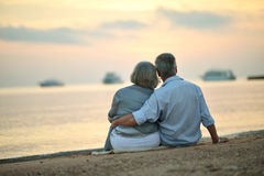 Mature couple relaxing on beach Stock Photo