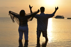 Mature couple relaxing on beach Royalty Free Stock Photo
