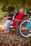 Mature couple relaxing on bench at park royalty free stock photo