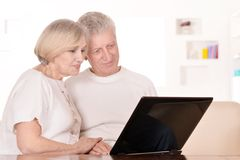 Mature couple relaxing at home Stock Photos