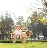 Mature couple relaxing in a park on beautiful day Royalty Free Stock Image