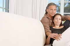 Mature couple relaxing on sofa. Royalty Free Stock Photos
