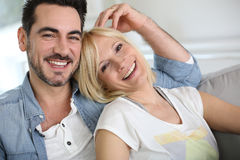 Mature couple relaxing in sofa Royalty Free Stock Photo