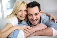 Mature couple relaxing in sofa Royalty Free Stock Image