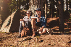 Mature couple relaxing at their campsite Royalty Free Stock Photography
