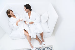 Mature couple relaxing together at day spa. Taking load off at day spa. Shot of loving mature couple enjoying drink while relaxing together at day spa Royalty Free Stock Photography