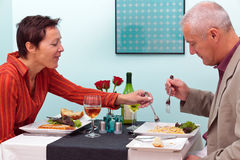 Mature couple in a restaurant Royalty Free Stock Photography
