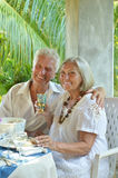Mature couple at restaurant Stock Images