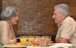 Mature couple at restaurant Royalty Free Stock Images