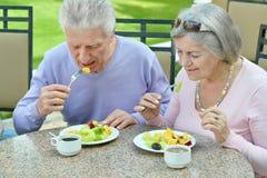 Mature couple at restaurant Stock Photos