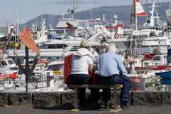 Mature Couple At Reykjavik's Old Harbor Royalty Free Stock Photos