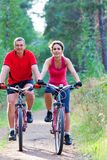 Mature couple riding  bicycle Royalty Free Stock Images