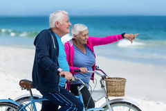 Mature couple riding bicycles Stock Images