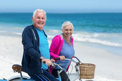 Mature couple riding bicycles Royalty Free Stock Photography