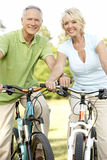 Mature couple riding bikes Stock Images