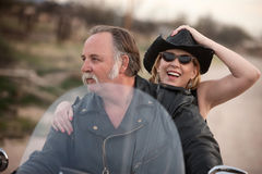 Mature Couple Riding a Motorcycle in The Desert Stock Photos
