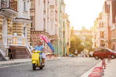 Mature couple riding on scooter. Royalty Free Stock Photography