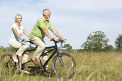 Mature couple riding tandem stock photos