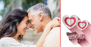 Mature couple romancing and valentine text Stock Images