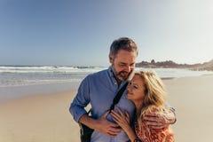 Mature couple on romantic beach vacation royalty free stock photos