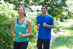 Mature Couple Running In Countryside. Together Royalty Free Stock Photography