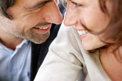 Mature couple's face looking each other Stock Photography