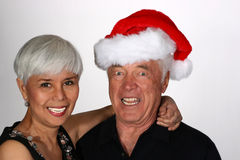 Mature couple with Santa hat Stock Photo