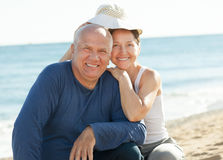 Mature couple at sea beach. Happy mature couple together at sea sandy beach Stock Photography