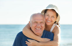 Mature couple at sea beach. Happy mature couple together at sea beach Stock Photography
