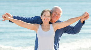 Mature couple at sea beach. Positive mature couple at sea beach Royalty Free Stock Images