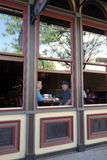 Mature couple seen through restaurant window. Royalty Free Stock Photos