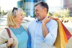 Mature Couple Shopping. Loving Senior Couple Outdoors Smiling Stock Photo