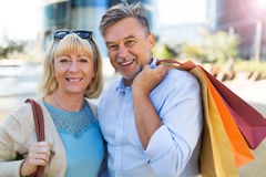 Mature Couple Shopping. Loving Senior Couple Outdoors Smiling Stock Photos
