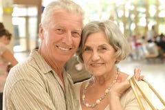 Mature couple at shopping mall Stock Photo