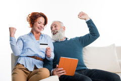 Mature couple shopping online Stock Images