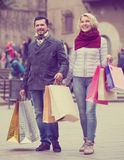 Mature couple in shopping tour. Portrait of mature couple chasing streets in shopping tour Royalty Free Stock Image