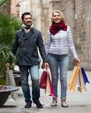 Mature couple in shopping tour. Portrait of smiling mature couple chasing streets in shopping tour Stock Photo