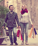 Mature couple in shopping tour. Portrait of smiling mature couple chasing streets in shopping tour Royalty Free Stock Images